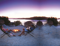 Couple relaxing at sunset, at the Kimberley Coastal Camp ©Tourism Western Australia_web